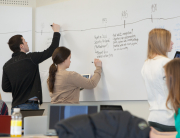 Students work in small groups dynamics and use the massive white board in Ellis Hall room 319